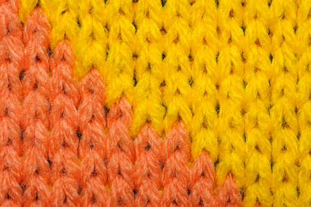 Yellow and red synthetic knitted fabric texture
