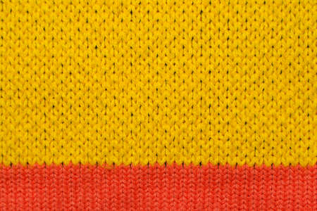 Yellow and red synthetic knitted fabric texture Archivio Fotografico