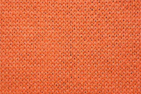 Red synthetic knitted fabric texture