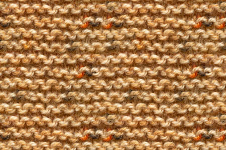 Brown Yellow Beige Color Knitwear Fabric Texture. Machine Knitting Texture Macro Snapshot. Beige Knitted Background. 版權商用圖片