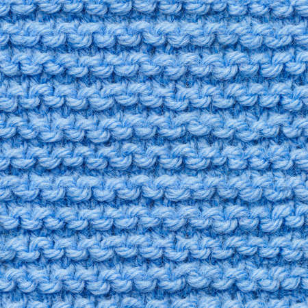 Blue knitted fabric seamless pattern for borderless fill. Knitted fabric repeating pattern for background close up. 版權商用圖片