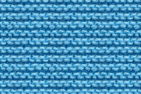 Blue Knitwear Fabric Texture. Machine Knitting Texture Macro Snapshot. Blue Knitted Background.