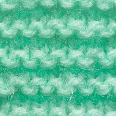 Turquoise, mint color knitted fabric seamless pattern for borderless fill. Knitted fabric repeating pattern for background close up.
