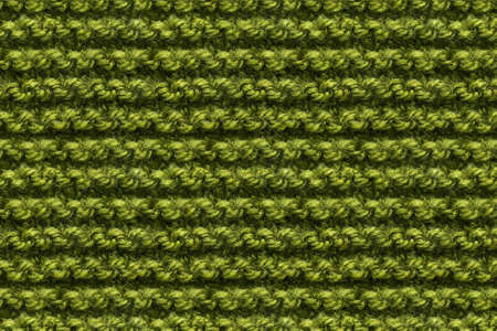 Green Knitwear Fabric Texture. Machine Knitting Texture Macro Snapshot. Knitted Background.