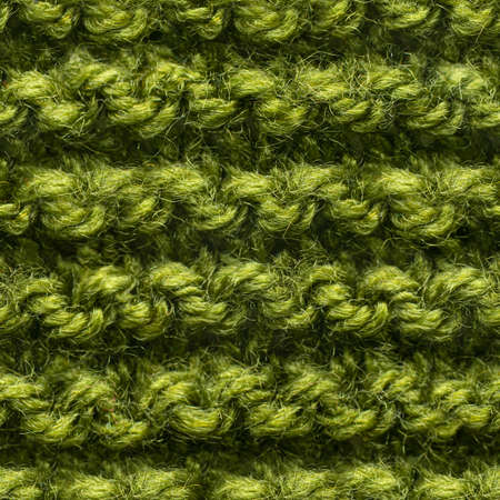 Green knitted fabric seamless pattern for borderless fill. Knitted fabric repeating pattern for background close up.