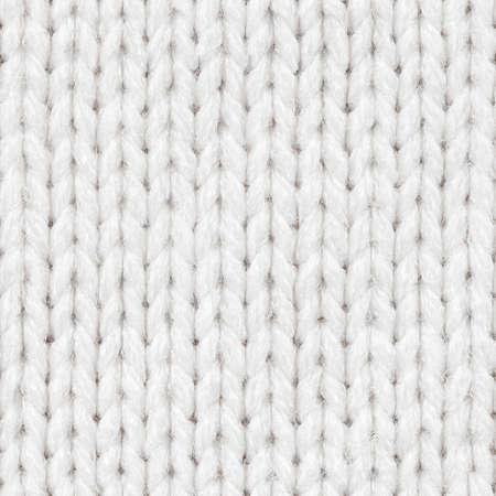 White knitted fabric seamless pattern for borderless fill. Knitted fabric repeating pattern for background close up.