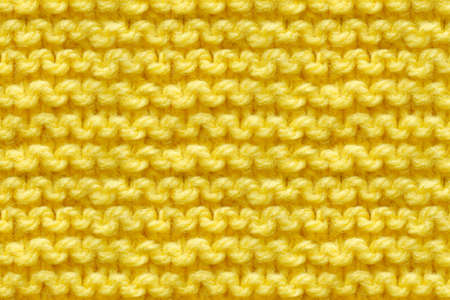 Yellow Knitwear Fabric Texture. Machine Knitting Texture Macro Snapshot. Knitted Background. 版權商用圖片