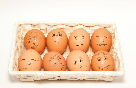 This is image of funny eggs on white  background photo