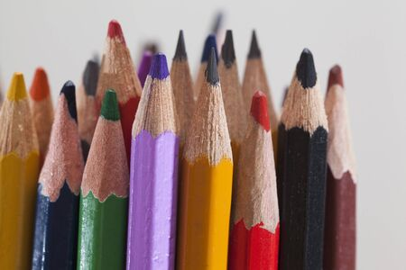 pencils of different colors on a gray background