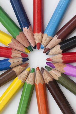 colored pencils lay in a circle Archivio Fotografico