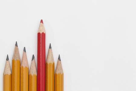 red and yellow pencils on white background
