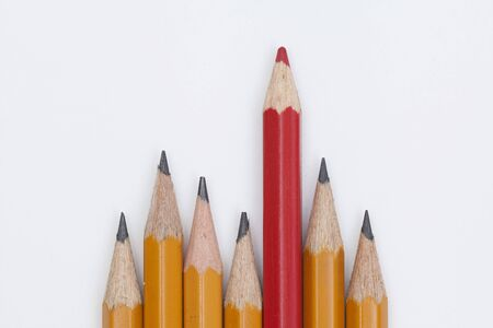 red and yellow pencils on white background. The concept of difference in society