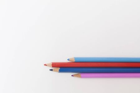 colored pencils in red and blue on a white background. the concept of family