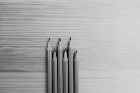 black and white photo of pencils on wooden background Archivio Fotografico