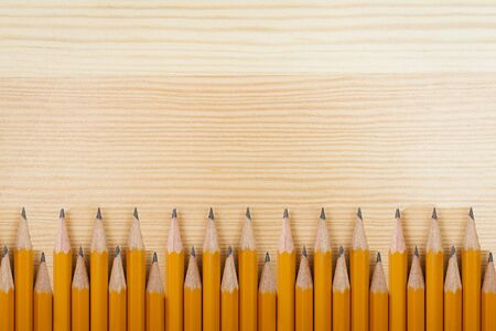 pencils on wooden background