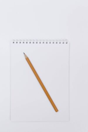 pencils lying on a white Notepad