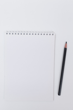 black pencil and white pad
