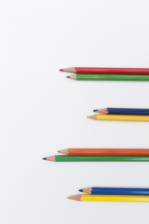 a pair of pencils of red, green, yellow and blue colors Archivio Fotografico