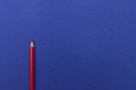 red pencil on a blue background Archivio Fotografico