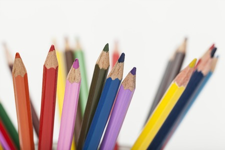 the tips of colored pencils on white background