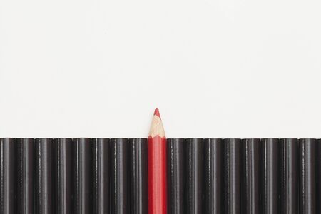 the concept of pencils. Red among the black Archivio Fotografico