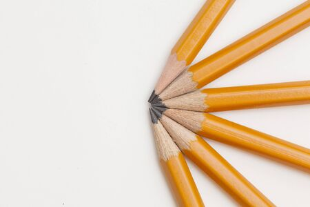 yellow pencils on white background