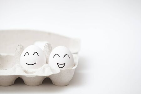 a couple of happy eggs in a carton Archivio Fotografico