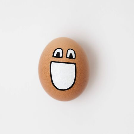 smiling egg on white background