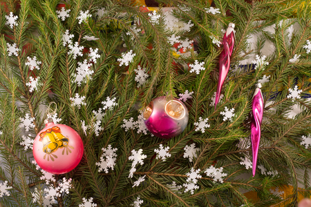 Christmas festive decoration of fir branches, snowflakes, Christmas tree decorations. Christmas and New Years background.