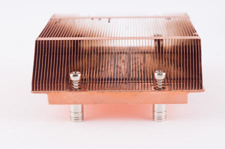 Used copper heat sink for cooling the microprocessor of the computer board. Radiator plates in large form. Stock Photo