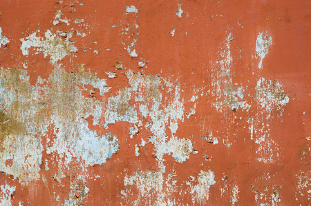 Multicolored peeling wall texture and background. Surface with stains. Stock Photo