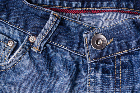 clasps: Jeans close-up. Clasps, pocket, seams, zippers,  button. Interlacing the fabric with a close-up Stock Photo