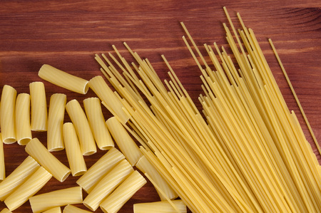Variety of types and shapes of Italian pasta. Dry pasta background. top view. Diet and food concept Stock Photo