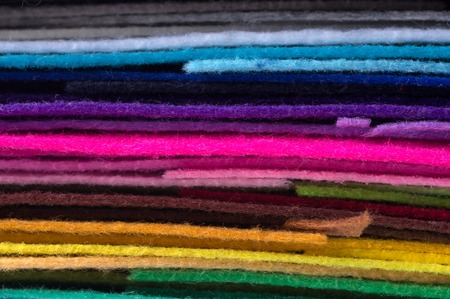 a stack of colorful acrylic felt. Multicolored macrophoto tissue