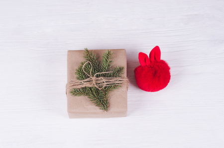 Christmas gift box and toy on a white wooden tbackground.   Christmas & New Year  concep