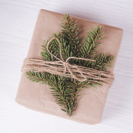 Christmas gift box on a white wooden background. Christmas & New Year composition.