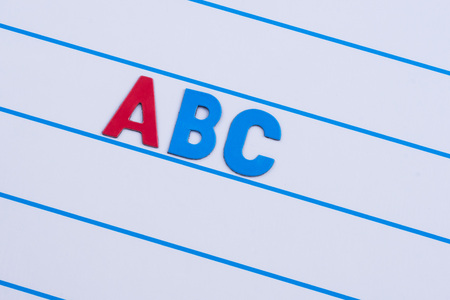 first three letters of the English alphabet on a magnetic board in line