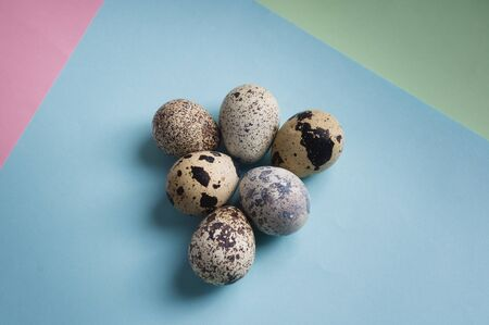 heap of quail eggs on color background. Vegetarian organic  eco food. Stock fotó