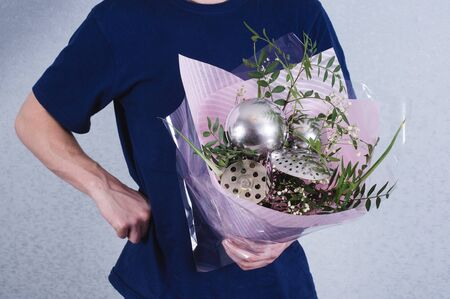 A man gives a bouquet of flowers and ladles. concept of patriarchal society and gender inequality.