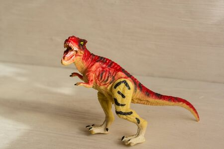 carnivorous dinosaur tyrannosaurus rex. plastic dinosaur figures of extinct ancient creatures and  favorite toys of kids