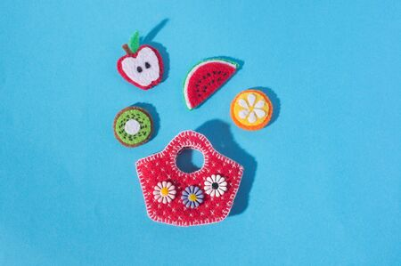 The composition of crafts made of felt  in the form of food and fruits. Hobbies and colorful crafts. View from above.