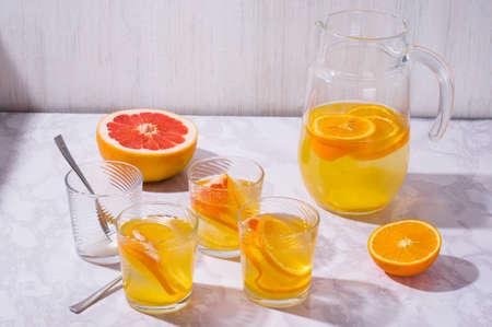 Lemonade. Drink with fresh orange, lemon and grapefruit. Lemon cocktail with juice. Citrus lemonade in glass jur. Refreshing summer drink