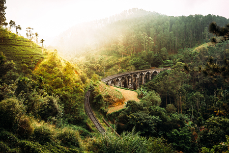 Nine-arch bridge in Sri Lanka. Beautiful railway bridge in Asia. Nature of Sri Lanka. Tea plantations in Asia. Colonial architecture Stock Photo