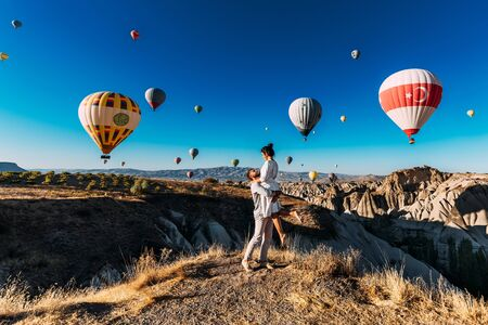 Happy couple in Cappadocia. The man proposed to the girl. Honeymoon in Cappadocia. Couple at the balloon festival. Couple travels the world. The Landscapes Of Cappadocia
