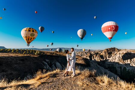 Lovers travel to Turkey. The man proposed to the girl. Family trip to Turkey. Couple at the balloon festival. Honeymoon trip. Couple travels the world. The Landscapes Of Cappadocia