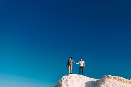 Couple travels. Man and woman standing on the mountain. A couple in love travels. A couple in Turkey. Honeymoon trip. Outdoor recreation. Follow me. Vacation in the mountains. Couple against the sky