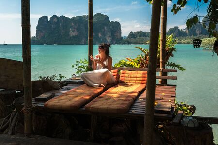 Beautiful girl resting on the sea. Lonely woman resting on the island. The girl on the Paradise coast. The girl on the Islands. A woman on a luxurious shore. Asian Islands. Holidays in Thailand 版權商用圖片