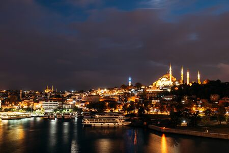 Night city Istanbul. Istanbul night landscape. Night view of the city. Galata Tower, Galata Bridge, Karakoy district and Golden Horn at night. 版權商用圖片