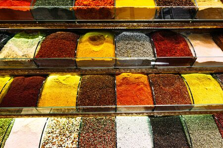 Colorful spices in a traditional Turkish Bazaar. Spices for cooking. Shop with spices. Sale of Oriental spices. East kitchen