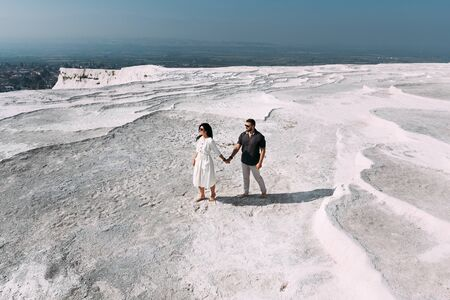 Couple in Pamukkale. Man and woman traveling. Couple in love walking. Travelling to Turkey. Honeymoon trip. Happy couple traveling. Wedding travel. Newly married couple. Honeymoon. Follow me